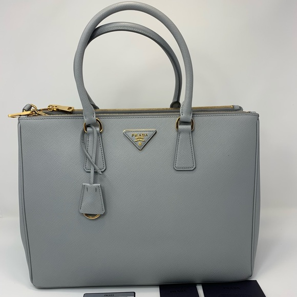 7a1cd2d6ed52fb Prada Saffiano Lux Large Granito Leather Tote. M_5c0afb88c2e9fea86b079e84.  Other Bags ...